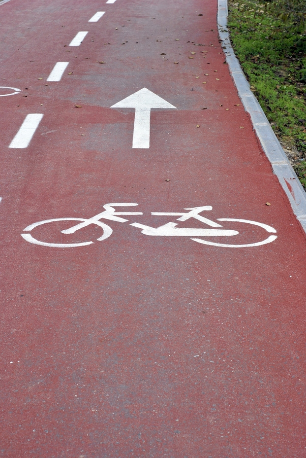 Bicycle way. Urban ground painted with symbols